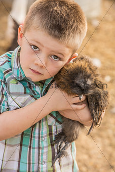 Boy Carrying Chicken