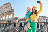 Mother and daughter taking a selfie at the Colosseum in Rome
