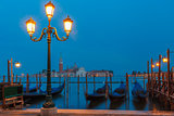 Gondolas at twilight in Venice lagoon, Italia