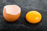 Raw egg close-up on black background
