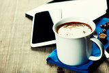 Cup of coffe with Digital tablet computer and smart phone