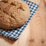 Freshly baked homemade bread on wood background