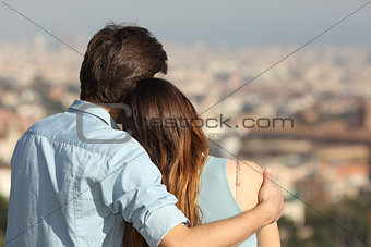 Couple dating in love and hugging watching the city