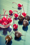 Chocolate and cocktail cherries on the glass