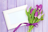 Purple tulip bouquet and blank photo frame