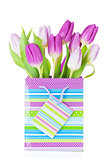 Purple tulip bouquet in gift bag