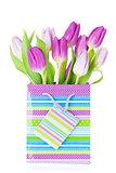 Purple tulip bouquet in gift bag