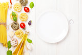 Italian food cooking ingredients and empty plate