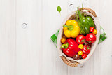 Fresh vegetables basket on wooden table
