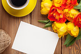 Colorful tulips, greeting card and coffee