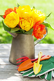 Colorful tulips and garden tools