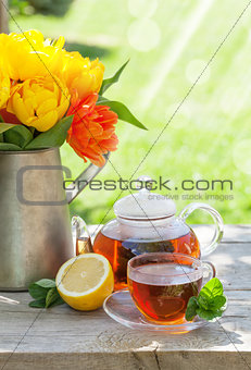 Breakfast tea and colorful tulips bouquet