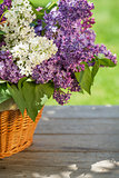 Colorful lilac flowers in basket