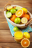 Citrus fruits and glass of juice