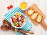 Healthy breakfast with salad, tomatoes and toasts