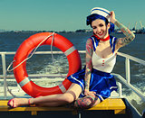 Pin-up girl sailor on the ship