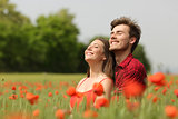 Couple hugging and breathing fresh air in a red field