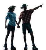 couple trekker trekking pointing nature silhouette