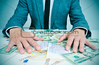 man in suit with dollar and euro bills