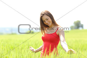 Candid girl playing with wheat in a field