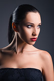 Studio fashion shot: portrait of beautiful young woman
