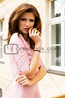 charming girl with building background