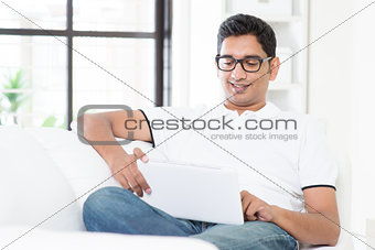 Indian male using digital computer tablet