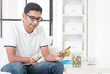 Sad Indian guy counting money
