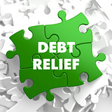 Debt Relief on Green Puzzle.