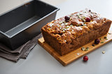 Closeup of fresh cranberry and pumpkin seed loaf
