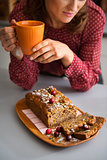 Closeup of woman's hands holding mug with home-made baking