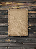 Empty wanted poster on plank wood wall