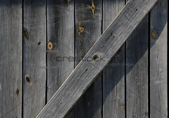 OId gray weathered barn door detail