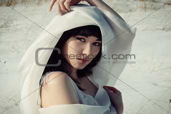 asian girl in winter with veil