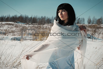 asian girl in winter field