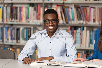 Portrait Of Clever Black Student With Open Book