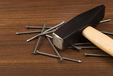 Hammer and set of nails on table