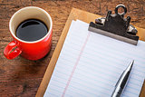 blank paper on clipboard and coffee