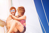 Joyful couple on sailboat