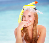 Cheerful young woman snorkeling