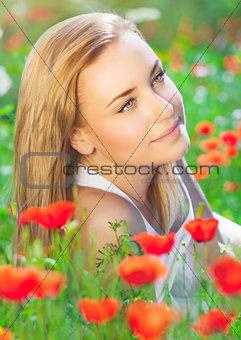 Beautiful woman on poppy field