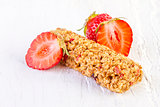 muesli bars with fresh strawberry on white wooden