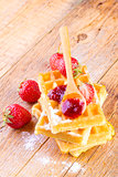 homemade waffles with strawberries maple syrup
