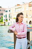 Woman standing by canal in Venice