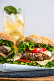 Homemade Hamburger with Fresh Vegetables and Drink with Ice