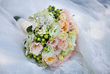 Wedding Bouquet on Bride's Dress