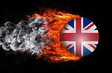 Flag with a trail of fire and smoke - United Kingdom