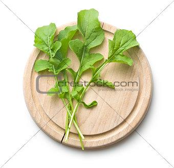 arugula leaves on cutting board
