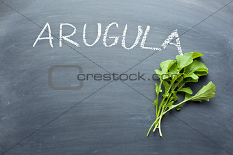 arugula leaves on chalkboard