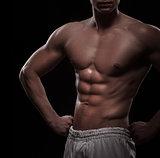 athletic man torso over black
